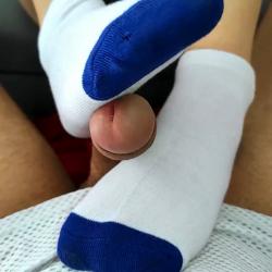 Girl gives footjob with socks